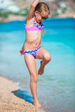 Adorable active little girl at beach during summer vacation in Europe Royalty Free Stock Photography