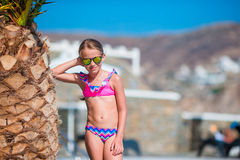 Adorable active little girl at beach during summer vacation in Europe. Adorable little girl at beach during summer vacation Royalty Free Stock Photography