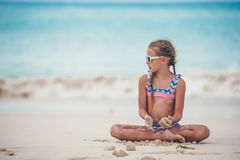 Adorable active little girl at beach during summer vacation stock images