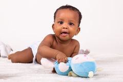 Adorable african american baby girl lying down stock image