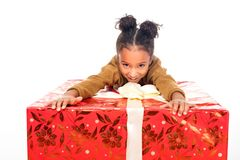 adorable african american child holding big gift box and smiling at camera stock photos