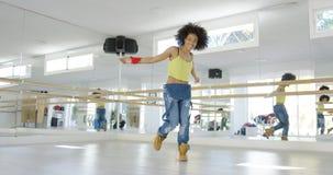 Adorable african american girl dancing in studio Royalty Free Stock Photos