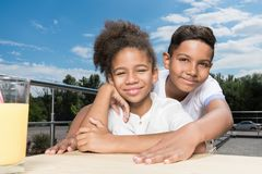 Adorable african-american kids embracing. Outdoors royalty free stock photos
