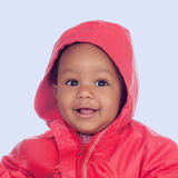 Adorable african baby with a beautiful smile and a red raincoat Royalty Free Stock Photos