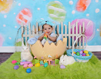 Adorable african baby boy sitting in giant easter egg Stock Images