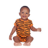 Adorable african baby with with brindle pajamas sitting on the f Royalty Free Stock Images