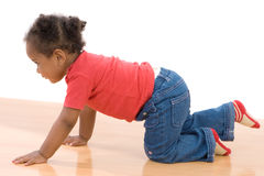 Adorable african baby crawl Stock Photo