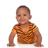 Adorable african baby lying on the floor Royalty Free Stock Photography
