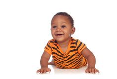 Adorable african baby lying on the floor Stock Photography
