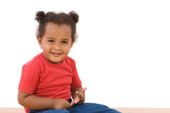 Adorable african baby sitting royalty free stock image