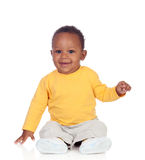 Adorable african baby sitting on the floor Royalty Free Stock Photography