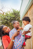 Adorable african family at balcony Stock Image