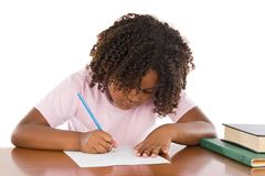 Adorable african girl writing Stock Image
