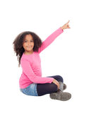 Adorable african little girl indicating something with her finge Royalty Free Stock Photos