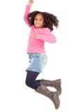 Adorable african little girl jumping Stock Photos