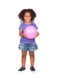 Adorable african little girl with pink ball Stock Image