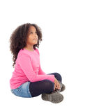 Adorable african little girl sitting on the floor Royalty Free Stock Photos