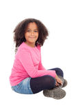 Adorable african little girl sitting on the floor Stock Photos