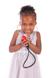 Adorable african little girl with stethoscope Royalty Free Stock Photography