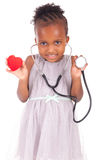 Adorable african little girl with stethoscope Stock Images