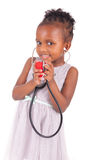 Adorable african little girl with stethoscope Royalty Free Stock Images