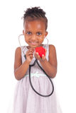 Adorable african little girl with stethoscope Stock Photos