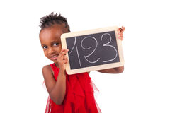 Adorable african little girl with slate Stock Photography