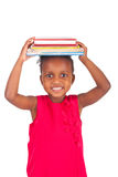 Adorable african little girl with book Royalty Free Stock Photos