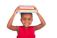 Adorable african little girl with book Royalty Free Stock Photo