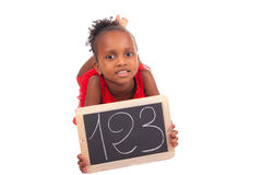 Adorable african little girl with slate Stock Images