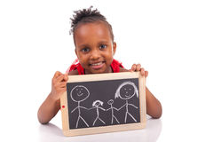 Adorable african little girl with slate Stock Photo