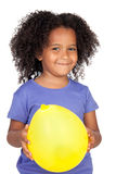 Adorable african little girl with yellow balloon Royalty Free Stock Photos