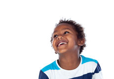 Adorable afroamerican child looking up Stock Photo