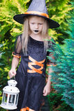 Adorable amasing little girl wearing witch costume Royalty Free Stock Photo