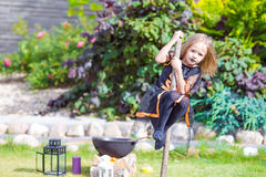 Adorable amasing little girl wearing witch costume Royalty Free Stock Photography