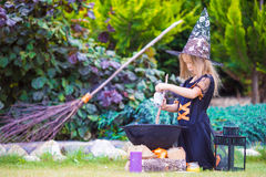 Adorable amasing little girl wearing witch costume Stock Photography