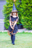 Adorable amasing little girl in witch costume on Stock Photo