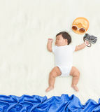 Adorable asian baby girl sleep on blanket with summer concept. Royalty Free Stock Photography