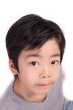Adorable asian boy looking at camera Stock Images