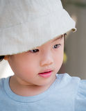 Adorable asian child girl concentrate on travel. Portrait of adorable asian child girl wearing hat concentrate on travel Stock Photos