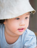 Adorable asian child girl concentrate on travel. Portrait of adorable asian child girl wearing hat concentrate on travel Royalty Free Stock Photos