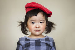 Adorable asian child looking at camera innocently.  Royalty Free Stock Photos