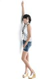 Adorable asian girl. Standing ob white background Royalty Free Stock Photography