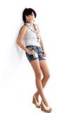 Adorable asian girl. Standing ob white background Stock Photos