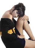 Adorable asian girl. Sitting ob white background Stock Photo