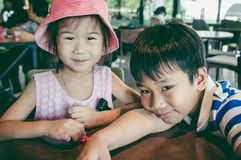 Lovely asian girl with her brother. Vintage tone. royalty free stock photo