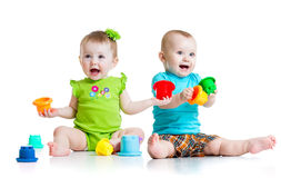 Adorable babies playing with color toys. Children Royalty Free Stock Photo