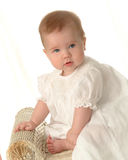 Adorable Baby. Girl in white on white background Stock Images