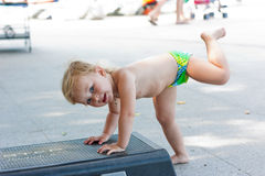 Adorable baby on aerobic step board Royalty Free Stock Image