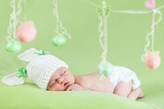 Adorable baby as Easter bunny with eggs Stock Images